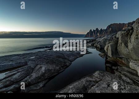 View over the sea towards Okshornan from Tunganeset on Senja Island in autumn, Arctic Norway - Stock Photo