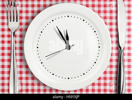 Blank clock on plate, time concept - Stock Photo