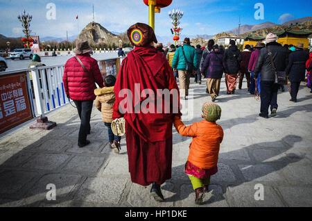 Tibet, Tibet, China. 17th Feb, 2017. Pious Buddhist pilgrims on their pilgrimage in southwest China's Tibet Autonomous - Stock Photo