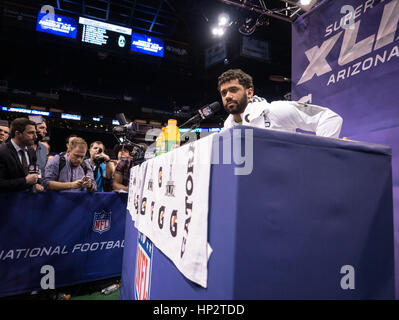 Seattle Seahawks' quarterback Russell Wilson is interviewed on Super Bowl Media Day on January 27, 2015 in Phoenix, - Stock Photo