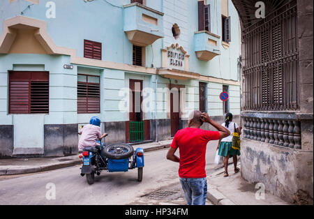 Street scene, motorcycle, vintage, in Cuba street, La Habana Vieja district, La Habana, Cuba - Stock Photo