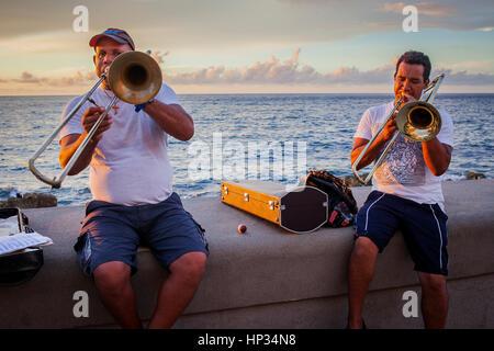 Busker, Men, Street artist, musician, in Malecón, La Habana, Cuba - Stock Photo