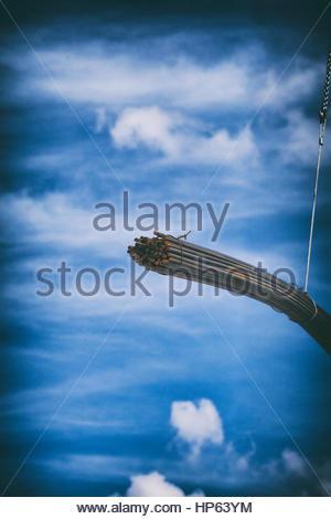 Construction crane chain steel rods lifting iron - Stock Photo