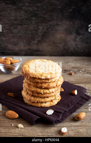 Homemade almond cookies on wooden table - healthy homemade vegan vegetarian pastry with almonds nuts - Stock Photo