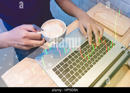 business trading concept : man trade stock and forex in notebook and analysis market financial data statistics chart - Stock Photo