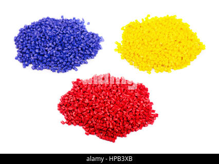 Colorful plastic polymer granules isolated on white background - Stock Photo
