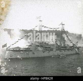 Antique c1910 photograph, unknown US Navy armored cruiser in port, flying 46-star Naval Jack which dates the photo - Stock Photo