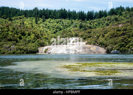 A scenic view of Orakei Korako geothermal valley entrance from Waikato river ferry, New Zealand, North Island - Stock Photo