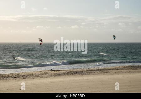 Two men kitesurfing on the beach in Indian ocean in Perth, Western Australia - Stock Photo