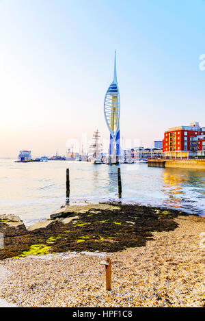 PORTSMOUTH, UNITED KINGDOM - JUNE 06: Portsmouth Emirates Spinaker tower taken from a distance on a pebble beach - Stock Photo