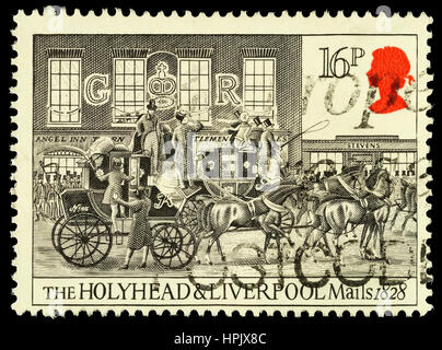 UNITED KINGDOM - CIRCA 1984: A used postage stamp printed in Britain celebrating the Bicentenary of the First Mail - Stock Photo