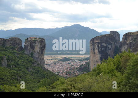 Meteora is formation of immense monolithic pillars and hills-like huge rounded boulders which dominate local area. - Stock Photo