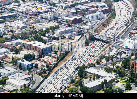 Los Angeles, USA - May 27, 2015: Aerial view of heavy traffic on Interstate 110, Santa Monica Boulevard is crossing. - Stock Photo