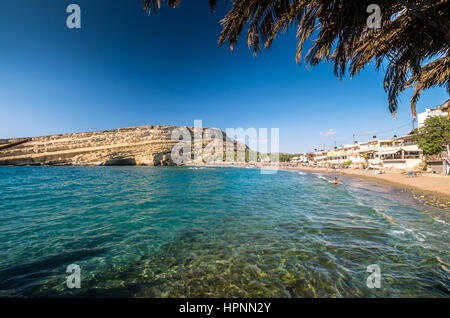 Matala beach on Crete island, Greece. View from the rocks. There are many caves near the beach. - Stock Photo