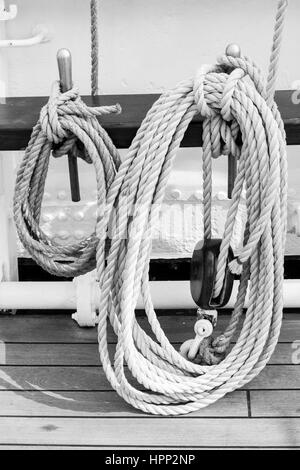 Ropes Tied To Metals On Railing In Boat - Stock Photo