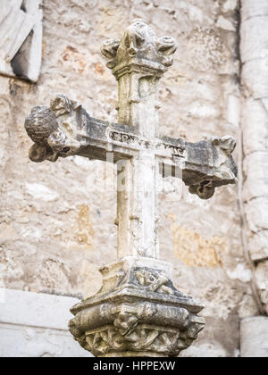 Stone cross in rhw Convent of Our Lady of Mount Carmel (Portuguese: Convento da Ordem do Carmo) in Lisbon, Portugal. - Stock Photo