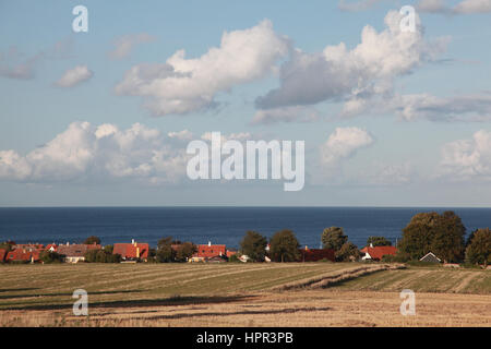 The Baltic Sea seen from agricultural land behind Svaneke, a small town on the island of Bornholm, Denmark - Stock Photo
