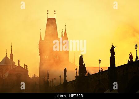 Mystery fog in sunrise. Charles bridge in Prague, Czech Republic. - Stock Photo