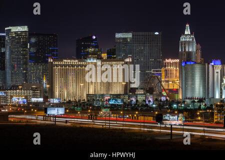 Editorial view of Las Vegas casino resorts and night traffic leading to the Las Vegas strip. - Stock Photo
