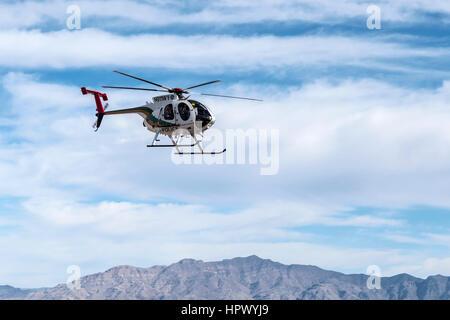 Las Vegas Nevada, USA - February, 6, 2015:  Las Vegas metropolitan police helicopter on patrol. - Stock Photo
