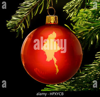 A red bauble with the golden shape of  Burma hanging on a christmas tree isolated on black.(series) - Stock Photo