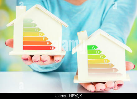 concept comparison between normal house and low consumption house with energy efficiency rating - Stock Photo