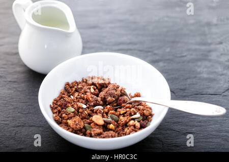 Healthy oat cereals on a wooden surface. Granola - Stock Photo