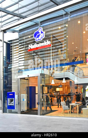 Glass front Nationwide building society premises & logo with ATM in shopping mall at Westfield shopping centre Stratford - Stock Photo