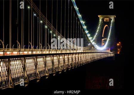 A night illuminated Clifton Suspension Bridge Bristol isambard Kingdom Brunel lights lit engineer Avon gorge tower - Stock Photo