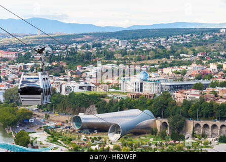 Peace Bridge over the Mtkvari river, Presidential Palace, Concert Hall and Exhibition Centre, Rike Park, Tbilisi, - Stock Photo