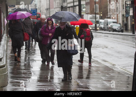 London, UK. 27th Feb, 2017. Pedestrians shelter from the rain and downpours in central London Credit: amer ghazzal/Alamy - Stock Photo