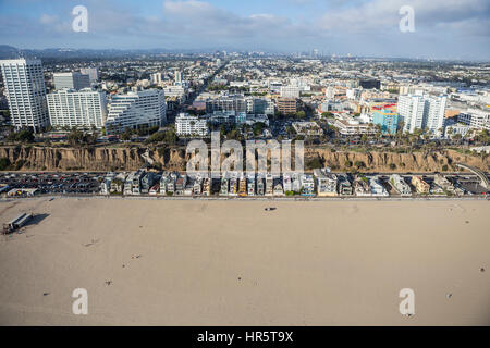 Santa Monica, California, USA - August 6, 2016:  Aerial view of Santa Monica's beach, homes, and central business - Stock Photo