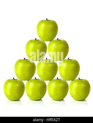 green apples on a pyramid shape over a white background - Stock Photo