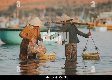 PHAN THIET, VIETNAM - November 9, 2016: Fishermen in Phan Thiet on November 9, 2016, Vietnam. - Stock Photo