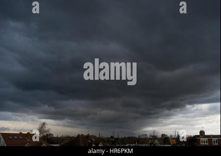 Wimbledon, London, UK. 27th February, 2017. Large formation of grey storm clouds move across London late afternoon - Stock Photo