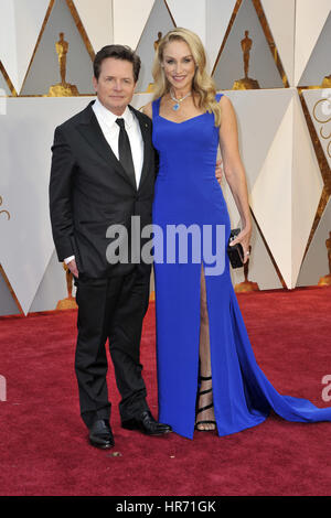 Hollywood, California. 26th Feb, 2017. Michael J. Fox and his wife Tracy Pollan attend the 89th Annual Academy Awards - Stock Photo