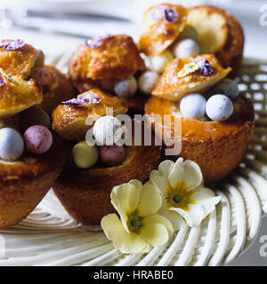 Cupcakes with Easter eggs. - Stock Photo