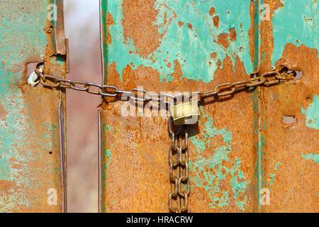Old rusty door with padlock - Stock Photo