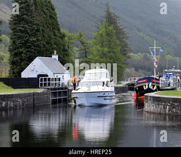 Boats going though Laggan lock, Scotland - Stock Photo