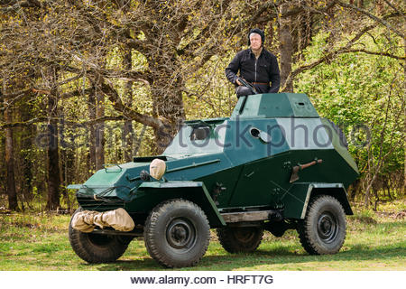 Pribor, Belarus - April 23, 2016: Re-enactor Dressed As Russian Soviet Crew Member Soldier Of World War II Sitting - Stock Photo