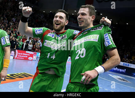 Magdeburg, Germany. 01st Mar, 2017. Magdeburg's Jacob Bagersted (L) and Mads Christiansen celebrate at the end of - Stock Photo