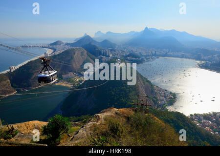 Cableway to the Sugarloaf Mountain, at back Copacabana, Rio de Janeiro, Brazil - Stock Photo