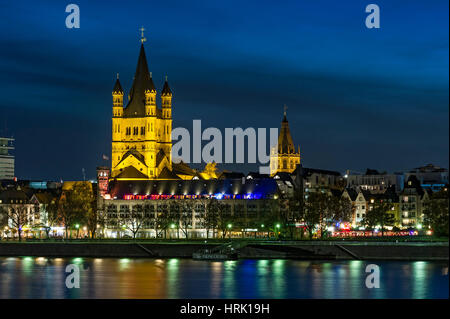 Romanesque church Groß St. Martin and Town Hall Tower, River Rhine, Historic centre, Night Scene, Cologne - Stock Photo