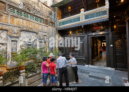 Tourists with local guides in the open courtyard of the Old House of Tan Ky. Hoi An Ancient Town, Quang Nam Province, - Stock Photo