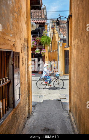 Narrow alley in Hoi An Ancient Town. Quang Nam Province, Vietnam. - Stock Photo