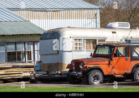 WHARTON, TEXAS, FEBRUARY 2017: An old Jeep in need of repair and an airstream trailer - Stock Photo