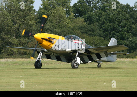 Ferocious Frankie, the P-51D Mustang flown by the Old Flying Machine Company landing at a airshow at Rougham in - Stock Photo