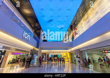 Tourists and locals shopping in a shopping center, Ion Orchard Shopping Center, Orchard Road, Singapore, Asia, Singapore - Stock Photo