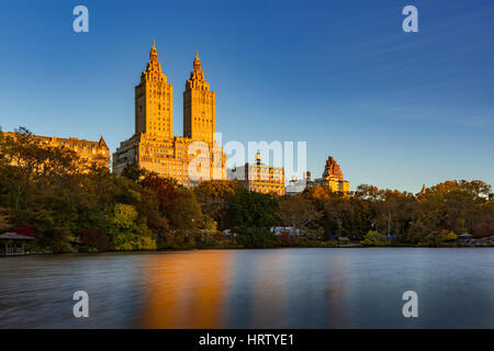 Sunrise on Upper West Side building and Central Park Lake. Manhattan, New York City - Stock Photo