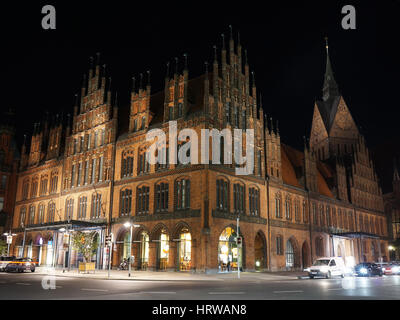 Hannover, Germany - September 9, 2016: Old Town Hall and Market Church illuminated at night. - Stock Photo